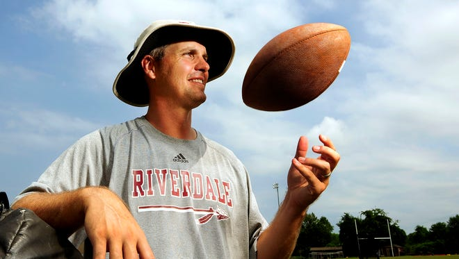 Former NFL quarterback Kelly Holcomb poses for a photograph at Riverdale High School in Murfreesboro, Tenn., Wednesday, July 29, 2015.