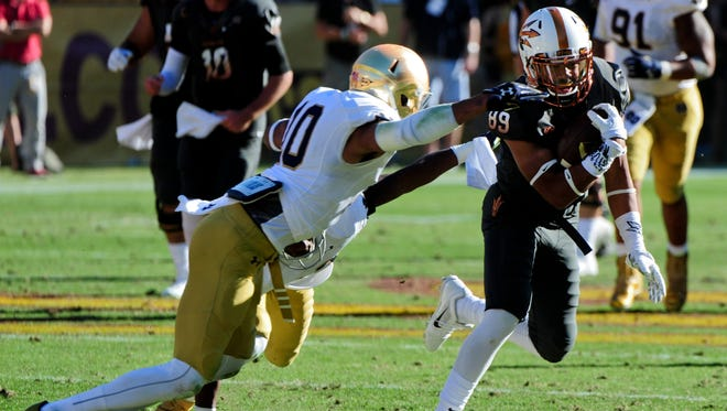Notre Dame safety Max Redfield, left, attempts a tackle against Arizona State during the 2014 season.