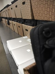 Students at the Sauk Rapids-Rice High School signed out their new Macbook Air computers Tuesday.