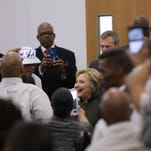 Democratic presidential candidate Hillary Clinton is greeted before speaking to Flint residents at the House of Prayer Missionary Baptist Church in Flint on Sunday February 7, 2016 about the Flint Water Crisis.
