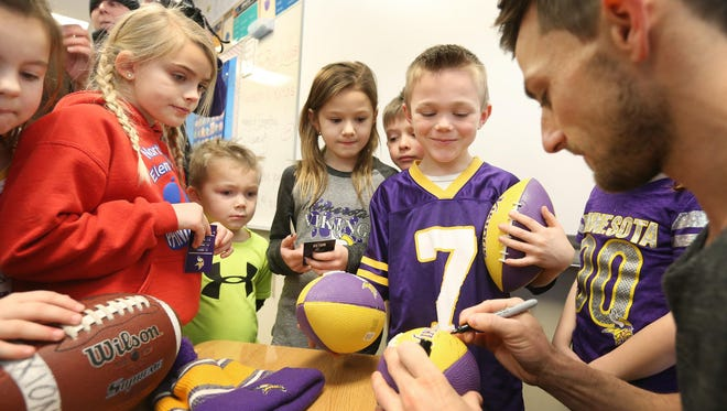 Minnesota Vikings kicker Blair Walsh signs autographs for first-graders during a visit Thursday to Northpoint Elementary School in Blaine. First graders at the school wrote letters of encouragement to Walsh after he missed a potentially game-winning field goal in last Sunday's NFL football playoff game against the Seattle Seahawks.