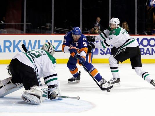 New York Islanders center John Tavares (91) takes a shot on Dallas Stars goalie Kari Lehtonen while being defended by Stars defenseman John Klingberg (3) in the second period of an NHL hockey game, Sunday, Jan. 3, 2016, in New York. (AP Photo/Adam Hunger)