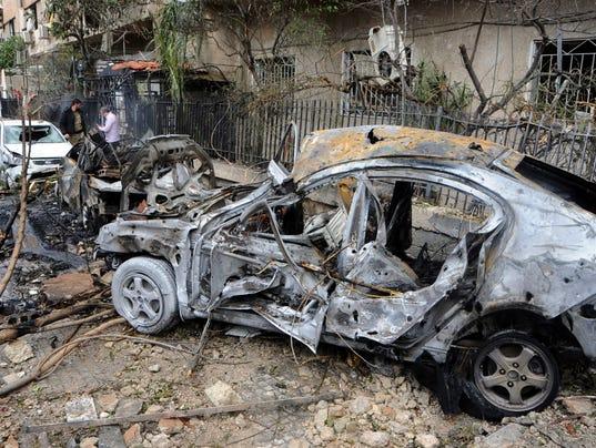 AP SYRIA CAPITAL UNDER FIRE I SYR