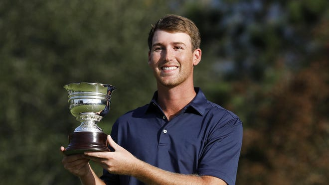 Andy Ogletree poses with the silver cup given to the low amateur finisher at the Masters Tournament. The U.S. Amateur champion finished at 2-under 286 for the week.