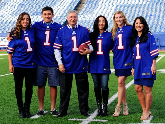 Left to right: Jessica Pegula, Matthew Pegula, Terry Pegula, Kelly Pegula, Laura Pegula, and Kim Pegula, stand near midfield as they pose for the media on the football field at Ralph Wilson Stadium in Orchard Park, N.Y.  Kim and Terry Pegula were introduced as the new owners of the Buffalo Bills today, Friday, Oct. 10, 2014.(AP Photo/Gary Wiepert)
