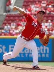 Cincinnati Reds starting pitcher Michael Lorenzen throws a pitch against the Miami Marlins in the first inning of a baseball game Sunday.