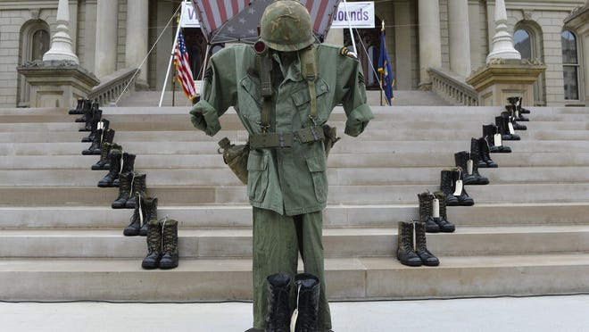 Twenty-two pairs of combat boots are on display during a presentation Thursday at the state Capitol. They represent the 22 veterans who commit suicide each day in the United States.