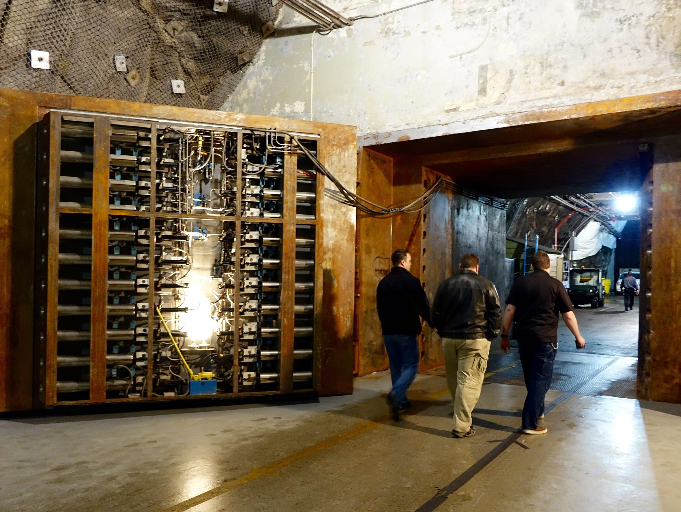 Workers enter the Cheyenne Mountain bunker through