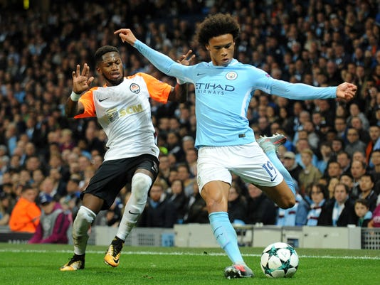Manchester City's Leroy Sane, right attempts a shot on goal as Shakhtar's Fred goes to challenge during the Champions League Group F soccer match between Manchester City and Shakhtar Donetsk at Etihad stadium, Manchester, England, Tuesday, Sept. 26, 2017. (AP Photo/Rui Vieira)