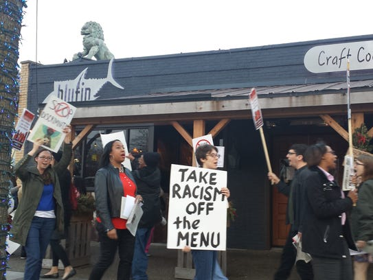 Protesters outside Blufin in Grosse Pointe Farms on