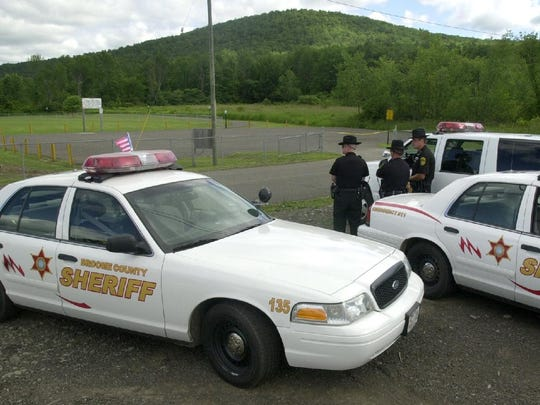 Broome County Sheriff Deputies at the scene July 6, 2002 across from the park on Grange Hall Road in Kirkwood.