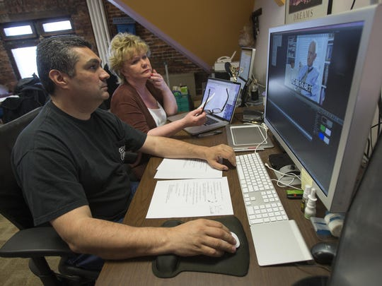 """Ramon Carrera (left) and Patty Spitler work on a project for """"Boomer TV,"""" a new television program airing on WISH-TV targeting the 50 and older set."""