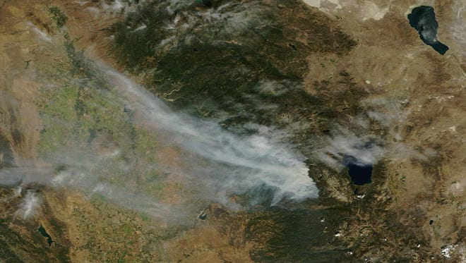 This NASA satellite photograph from Saturday shows smoke from the King Fire being blown away from the Reno area. That could end today.