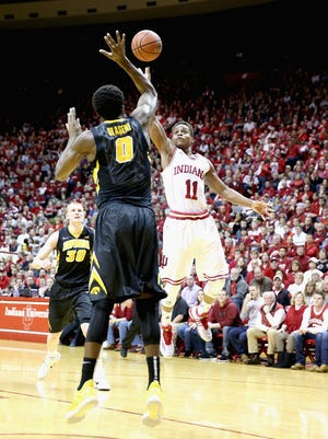 Yogi Ferrell shoots the ball during the game against the Iowa Hawkeyes at Assembly Hall on March 3, 2015 in Bloomington, Ind.