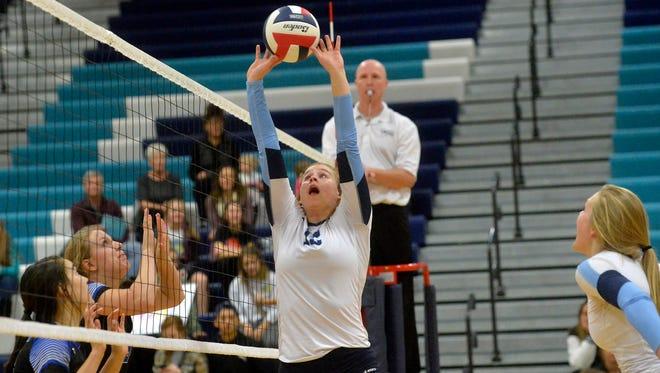 Great Falls High's Danielle Devlin makes a set at the net.