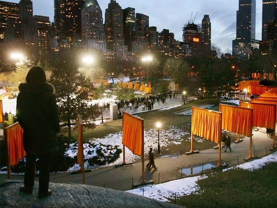 """In 2005  """"The Gates,"""" a 16-day art exhibit created by Christo and Jeanne-Claude, debuted in New York's Central Park with the unfurling of saffron-colored fabric banners suspended from 16-foot-high frames."""
