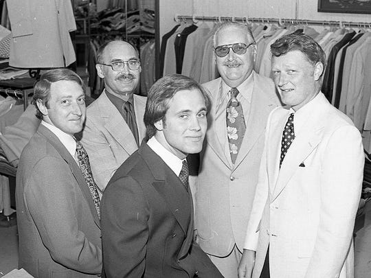 A 25th anniversary photo includes Wayne Holden, back left, Marshall Reid, Joseph Holden, Bob Holden, and Bob Reid (front).