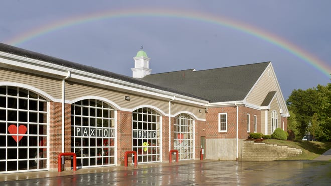 PAXTON - A rainbow spans the police and fire station on Pleasant Street (Route 122) after a rainshower Wednesday.