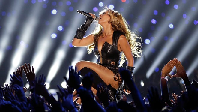 Beyonce performs during the 2013 Super Bowl halftime show in New Orleans.