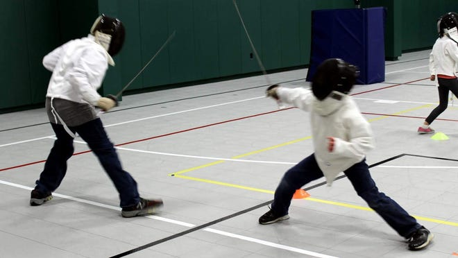 Hawkan Richards, left, and Sean Loyal face off during their fencing lesson at Victor Parks and Recreation.