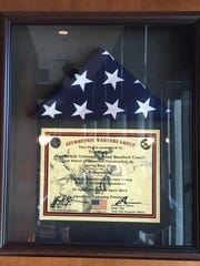American flag and certificate of authenticity displayed in Vanderbilt baseball coach Tim Corbin's office. The flag was flown in Afghanistan and given to Corbin by Army Reserve Sergeant First Class Jonathan Freudenthal.