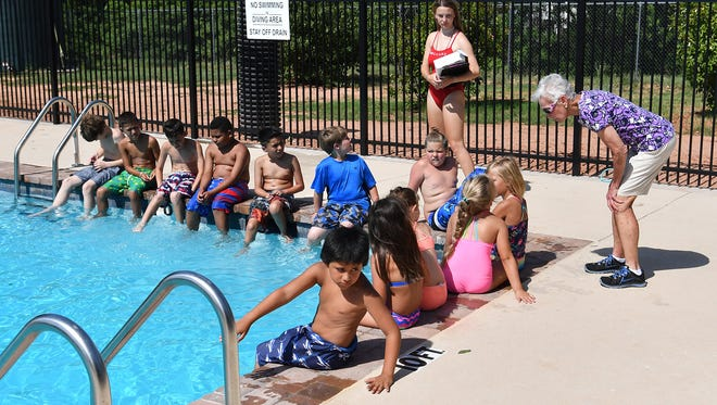 Camp Fire North Texas Executive Director Bettye Ricks, right, talks to some of the 4th graders getting ready to swim in the deep end of the new swimming pool.