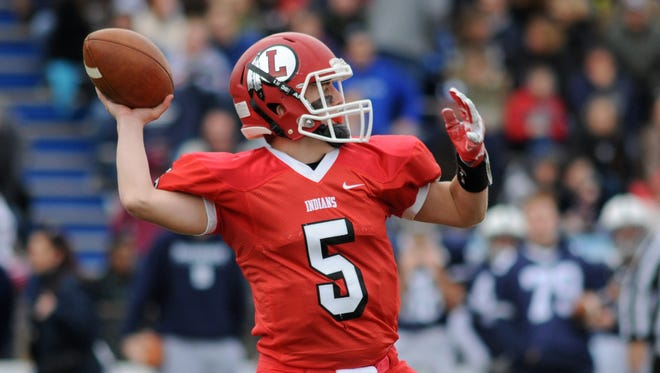 Lenape quarterback Matt Lajoie delivers a pass during action in the Indians' 31-10 victory over Shawnee last fall.