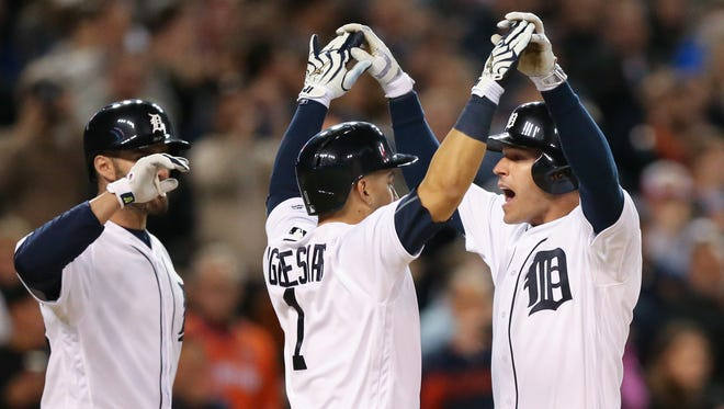 Tigers shortstop Jose Iglesias celebrates with second baseman Ian Kinsler, who homered during the seventh inning of the Tigers' 7-2 win Tuesday.