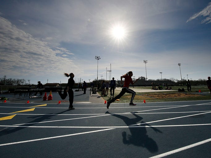 Competitors warm-up under the spring sun before the