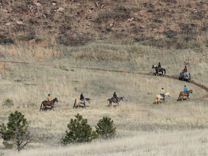 Horseback riders follow a trail at Lory State Park in Bellvue Sunday, March 23, 2014. ItÕs been a year since the 1348-acre Galena Fire west of Fort Collins and dry grasses and vegetation may pose a threat in a possible early fire season in the next few weeks.