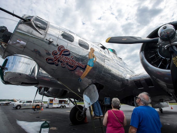 People admire the Sentimental Journey, an authentically restored WWII Boeing B-17 Flying Fortress on view at the Ocean City -Wicomico Regional Airport. The B-17 Flying Fortress was the primary bomber used by the American Air Force in the war. The nose art is of Betty Grable, in the most famous pinup picture of WWII. Cockpit tours are being offered at a cost of $5.00 per person and ground viewing and photo opportunities are free to the public from 9 a.m. - 5 p.m. each day through September 7. Flights are also available for a cost.