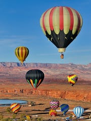 About 60 colorful hot-air balloons will take to the
