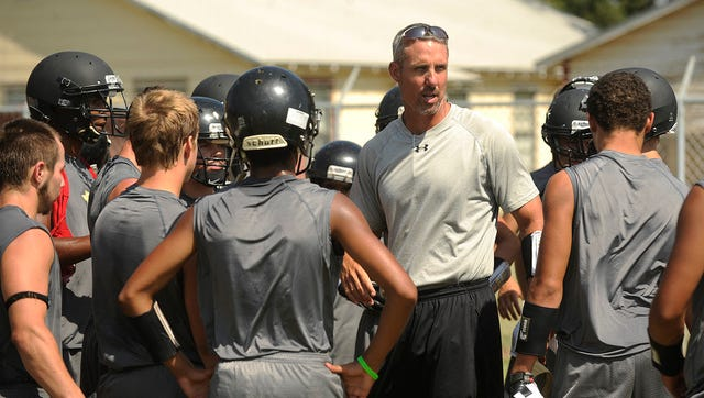 Thomas Metthe/Reporter-NewsHaskell head coach Grady Benton talks to his players during the Indians' during the Indians' practice on Thursday, Aug. 8, 2013, at Haskell High School.