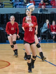 St. Philip's Taylor Pessetti sets the ball against