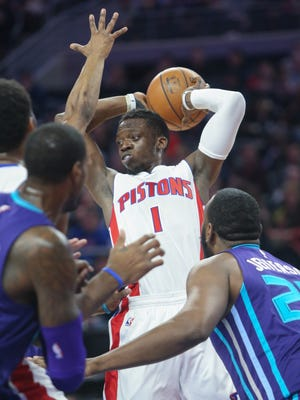 Pistons guard Reggie Jackson passes during the second period of the Pistons' 112-105 win over the Hornets Friday at the Palace.
