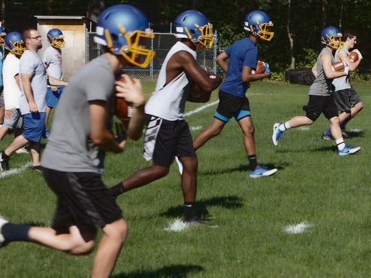 Milton High School's football team gets to work Monday,