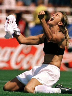 The United States' Brandi Chastain celebrates after kicking the game-winning overtime penalty shootout goal against China during the Women's World Cup Final at the Rose Bowl in Pasadena, Calif., in 1999.