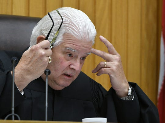 Senior Judge Paul Summers during a bench conference with attorneys at the trial of Raynella Dossett Leath in court Thursday, May 4, 2017.  Leath faces an extraordinary third trial this week in Knox County Criminal Court on the same charge for which she was tried twice before — that she killed her second husband.