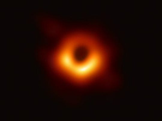 """An international team of scientists, including researchers from the University of Arizona, released the first image ever taken of a black hole in a nearby galaxy in April 2019. The Event Horizon Telescope is a network of eight telescopes, including two affiliated with the University of Arizona, that were combined into a single """"virtual"""" telescope to observe the black hole."""