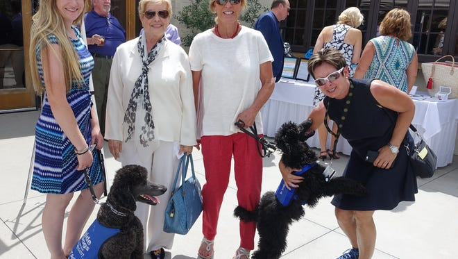 Megan Dunn, apprentice trainer; Yvonne Maloney, event host; Judy Northrup, puppy raiser and Betty Callies from ACBCI.