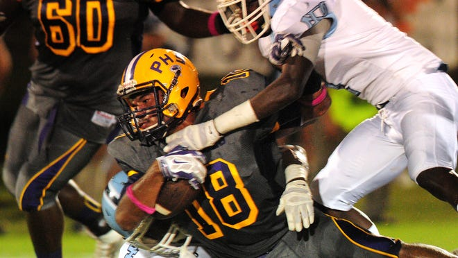 Purvis High School player Levi Sumrall (18) fights for yardage during the game against North Pike High School Friday.