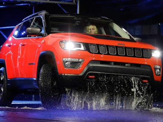 The 2017 Jeep Compass arrives onstage at the Los Angeles