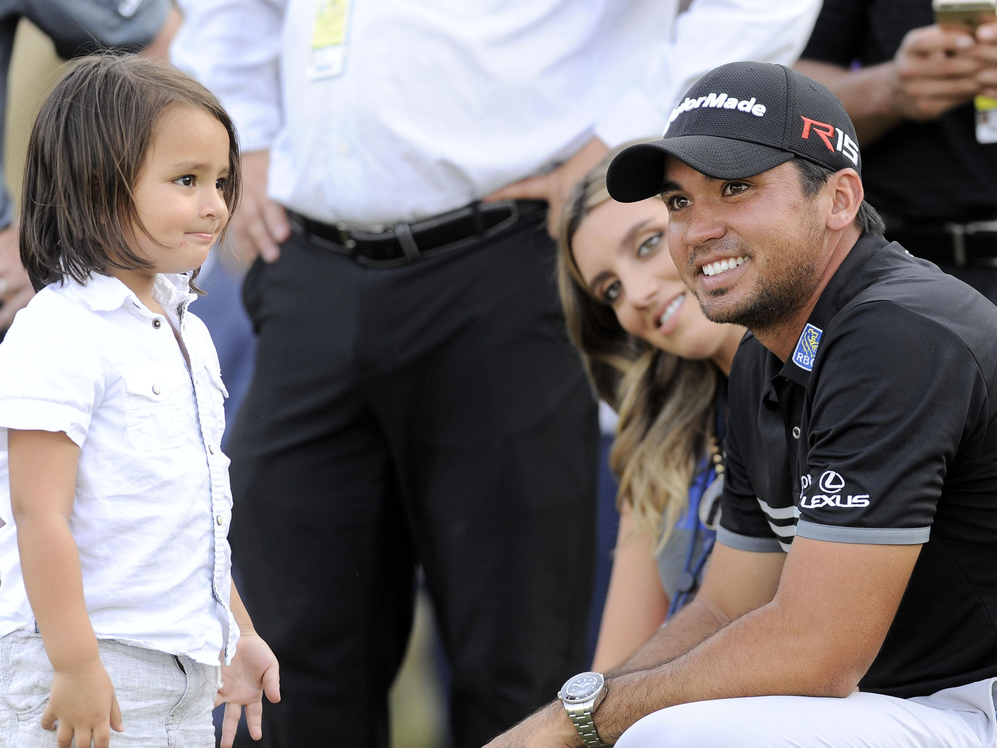 Jason Day with his son Dash Day and his wife, Lucas native Ellie Day after winning the 2015 PGA Championship golf tournament at Whistling Straits.