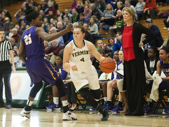 Vermont's Hayley Robertson (4) dribbles the ball past