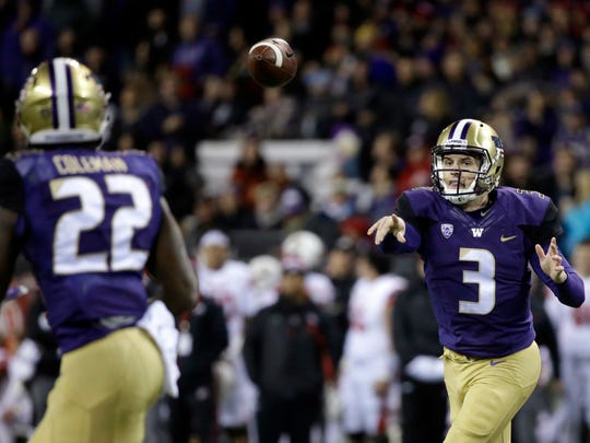 Washington quarterback Jake Browning (3) throws a 6-yard touchdown pass to Lavon Coleman durning the first half of the Huskies' win over Utah on Saturday.
