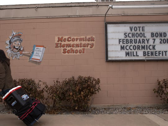 A sign alerts voters about an upcoming school bond