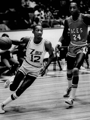 Glenn Hagan with the Rochester Zeniths basketball team drives around Scranton's Guy Arnold in this 1980 file photo.