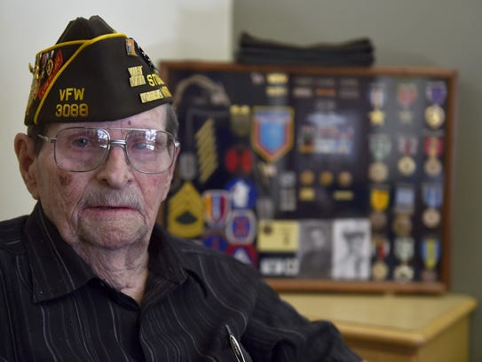 Orville Kugler was blinded in his left eye from a shrapnel wound while serving as a medic in Korea. A shadow box of his medals including the purple heart, silver and bronze medals of honor are displayed near his bedside. He is confined to a wheelchair. He retired after serving 20 years in the U.S. Army.