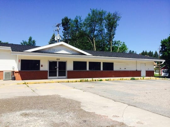 An old Kwik Trip at 1500 Grand Ave., shown here on June 23, 2015, may become a pharmacy and clinic. The city, which owns the property, is working out the details with Forrest Young, who proposed the development.