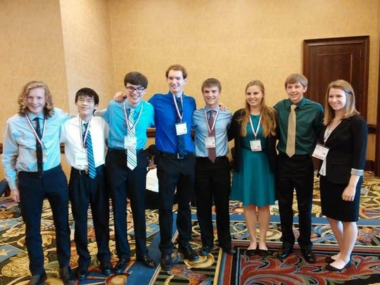A West High team, from left to right: Josh Jensen, Kevin Liu, Schuyler Cantrell, Benjamin Johnson, Daniel Smith, Maggie Southwick, Adam Weis and Sabrina Bretz.